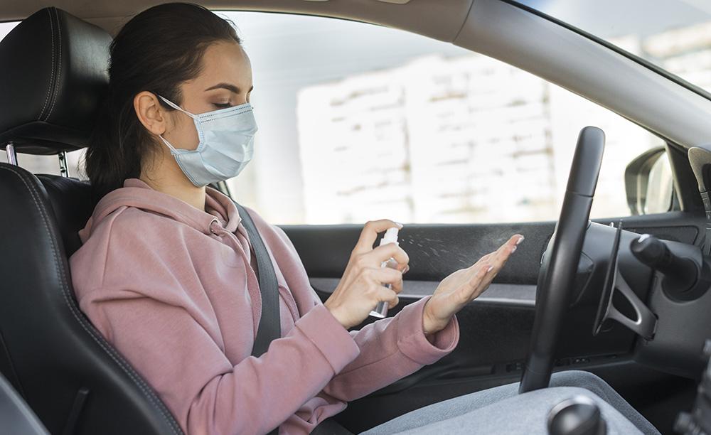 https://www.freepik.com/free-photo/woman-wearing-mask-using-hand-sanitizer_7763698.htm